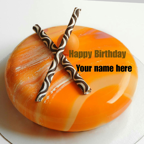 Write Name On Orange Birthday Cake With Chocolate Stick