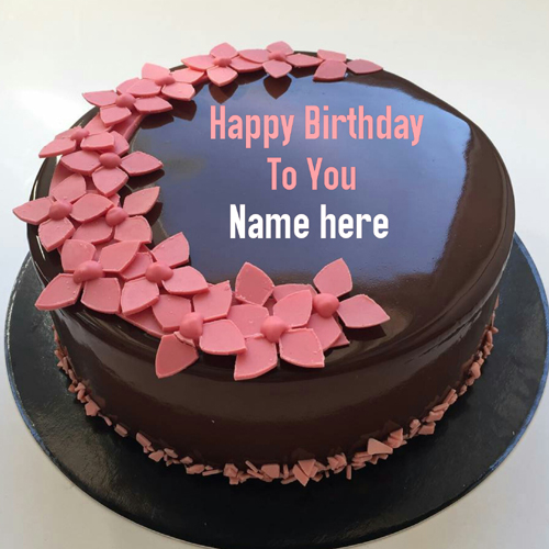 Chocolate Birthday Name Cake With Flowers On It