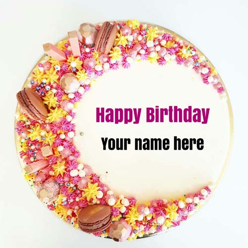 Multicoloured flower decorated birthday cake with name