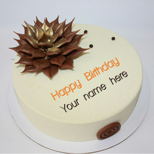 Write Name On Vanilla Cake With Chocolate Flower On It